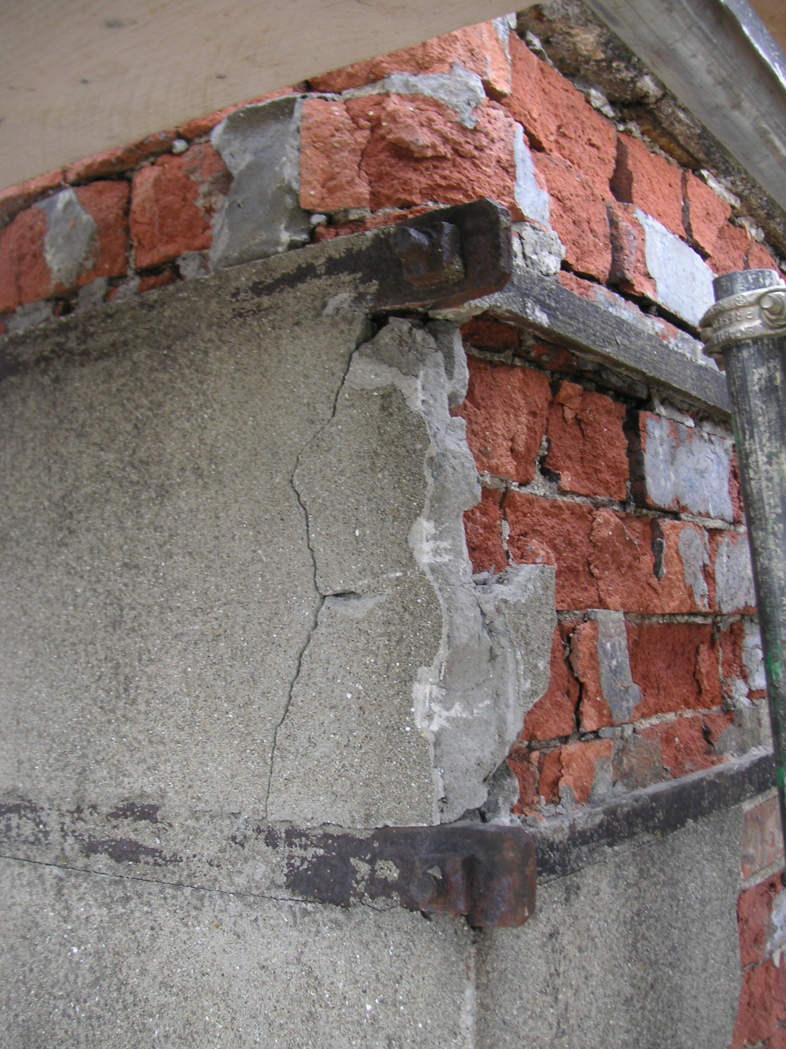 Brick damaged by cement render at Brandon House Hotel